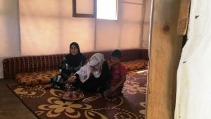Muazzaz Ali and her daughter Lama Farzad, Syrian refugees from Homs, sit inside their tent in a refugee camp in the Bekaa Valley, Lebanon (photo: DW/A. Vohra)
